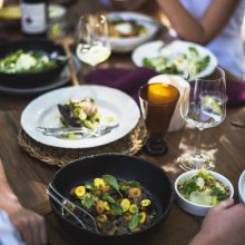 Table with people, food and wine